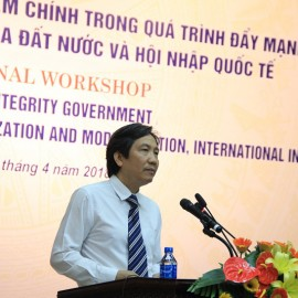 Dr. Tran Anh Tuan, Vice Minister of Home Affairs delivers a speech in the seminar