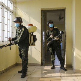 Staff spray disinfectant at a dormitory in Ho Chi Minh city for for the city to use it as centralized facility to quarantine those coming to Vietnam from areas hit by Covid-19, March 18, 2020. Photo by VnExpress/Quynh Tran