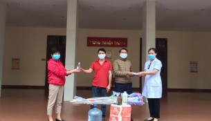 NAPA officers giving Lao students medical masks, sanitizers, sanitary equipment to prevent and control the epidemics and necessities for COVID-19 prevention and sosial isolation