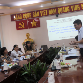 Mr. Tran Quang Son, lecturer, Division for Foreign Language  - Informatics and Information - Library presenting at the seminar