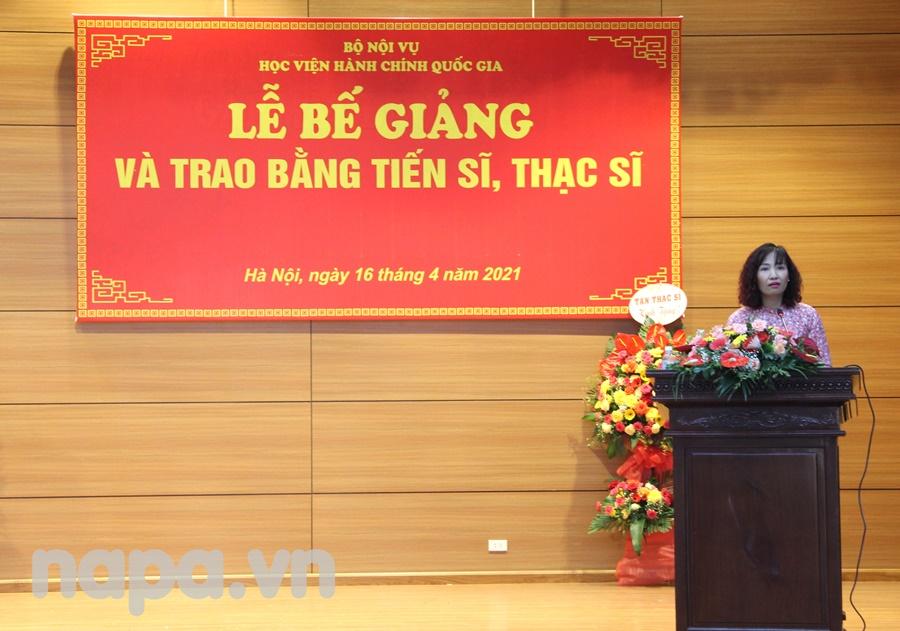Ms. Do Thuan An, Head, Division of Graduate Training Management  announcing the decision of conferment of master degrees