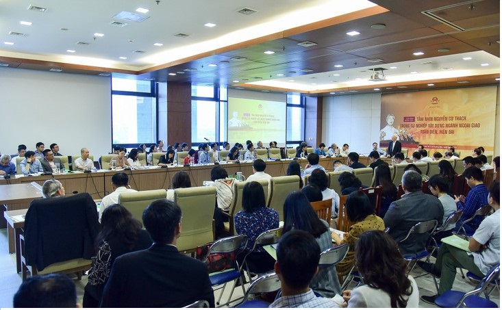 """Participants attending the symposium """"Nguyen Co Thach's vision in  building a comprehensive and modern diplomatic sector""""."""