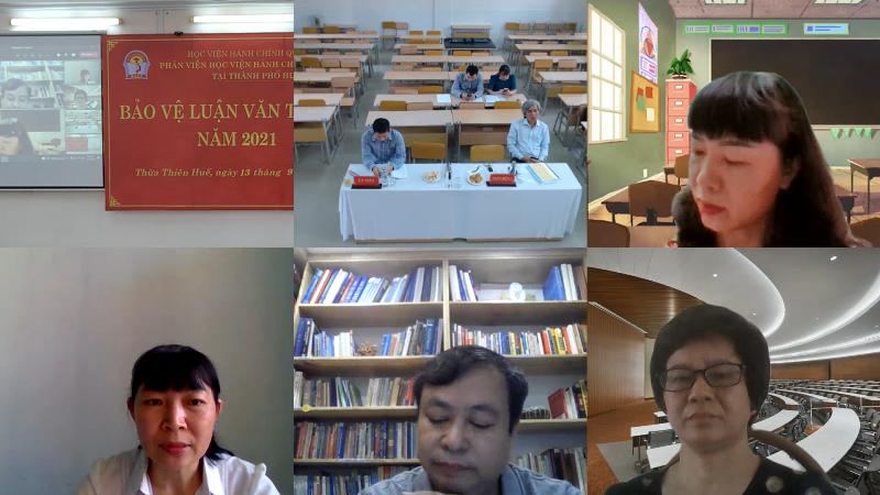 Các thành viên Hội đồng chấm luận văn tại điểm trực tuyến nghe học viên trả lời các câu hỏi